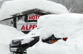 Cars covered with snow in St. Anton